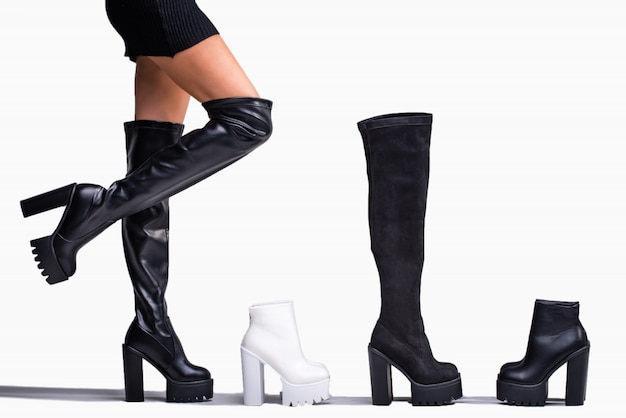 Black hessian boots on the legs of the model on a white background with shadows