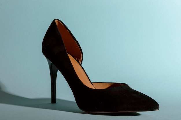 Black high-heeled suede shoes