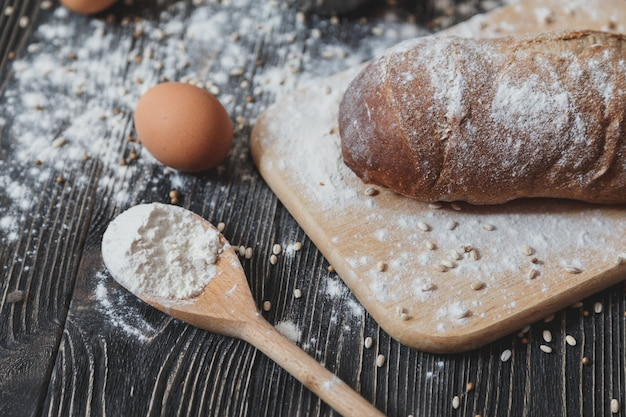 Black homemade bread and its ingredients