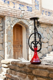 Black hookah with ruby bulb in authentic oriental antique cafe