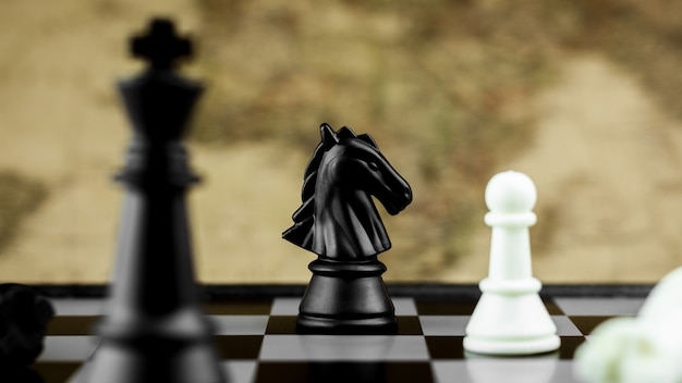 Black horse chess figures on board.- business idea for competition