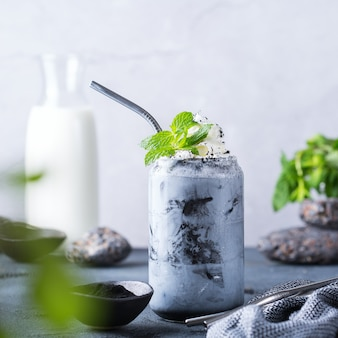 Black iced activated charcoal latte with coffee and vegan milk. detox, refreshing summer drink