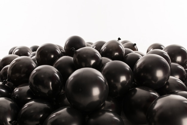Black inflatable balls for the holiday. in studio on a white background.