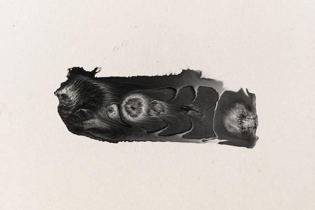 水彩紙のテクスチャ背景に黒インクの形 Premium写真