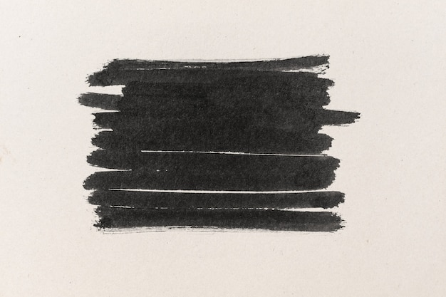Black ink shape on water color paper textured background