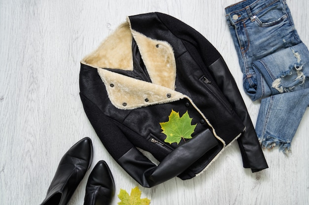 Black jacket, boots, jeans and maple leaves
