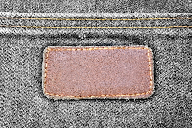 Black jeans texture denim with lather tag background pattern