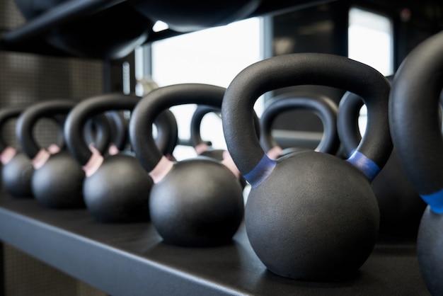 Black kettlebells in modern gym