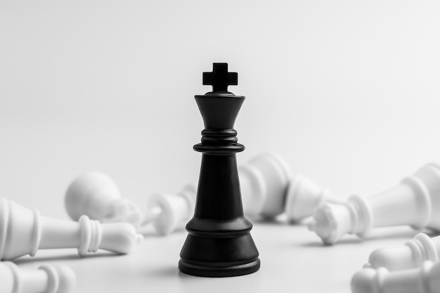 Black king chess stand alone in among the losers