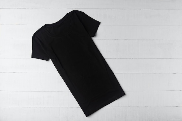 Black knitted t-shirt on white surface