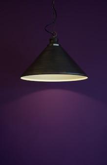 Black lamp on purple wall