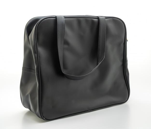 Black leather bag on white