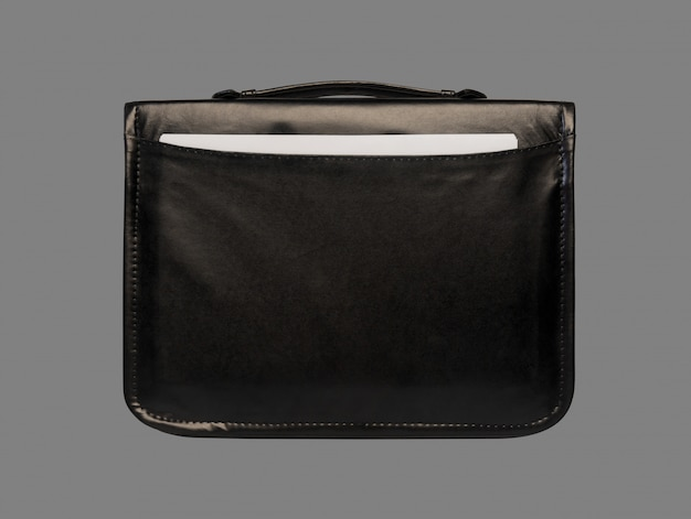 Black leather briefcase with documents close-up isolated on a grey background