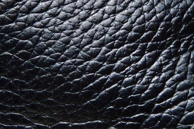 Black leather texture. close-up. view from above.