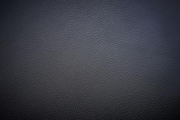 Черная кожаная текстура крупным планом
