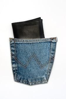 Black leather wallet in jeans pocket