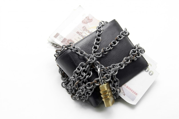 Black leather wallet with numeric pad lock and thai banknote