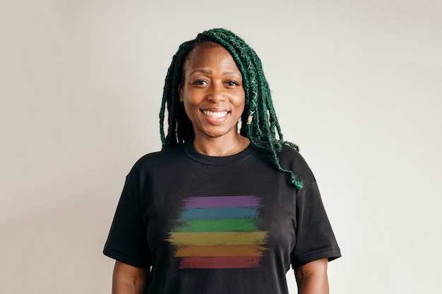 Black lesbian wearing a rainbow print t-shirt