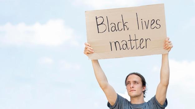 Black lives matter concept person holding cardboard