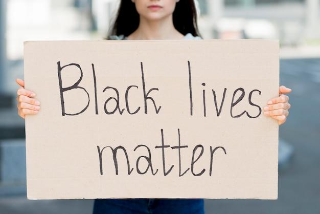 Black lives matter written on cardboard