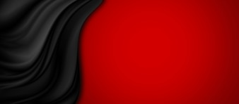 Black luxury fabric on red background with copy space