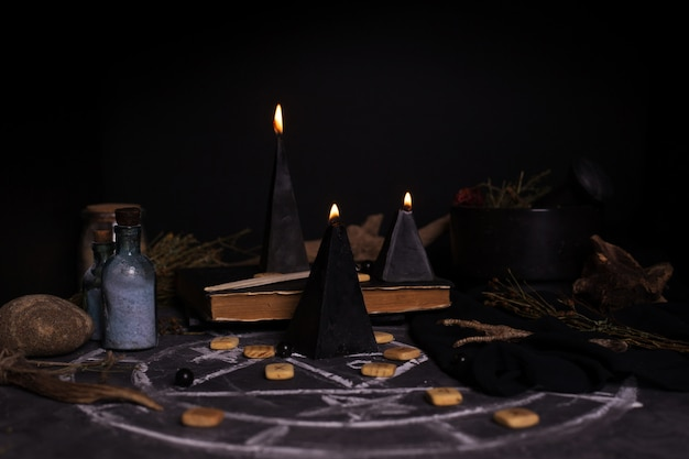 Black magic ritual with candles and runes