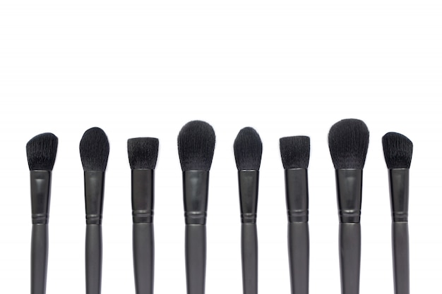 Black makeup brushes isolated on white space
