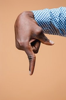 Black male hand point finger. hand gestures - man pointing on virtual object with forefinger