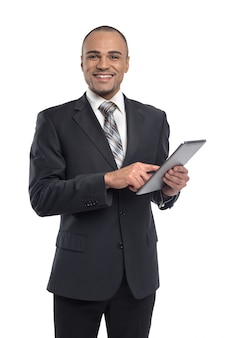 Black man businessman holding black digital tablet with copy space screen