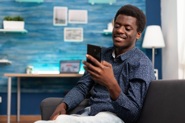 Black man greeting colleagues on video call conference