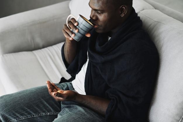 Black man having pills