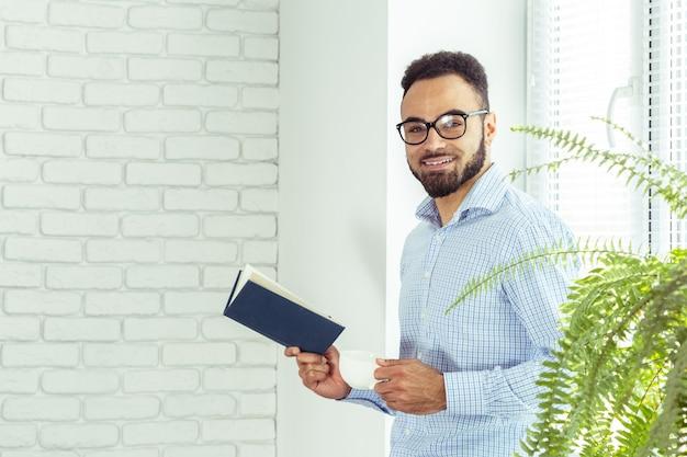 Black man holding a book
