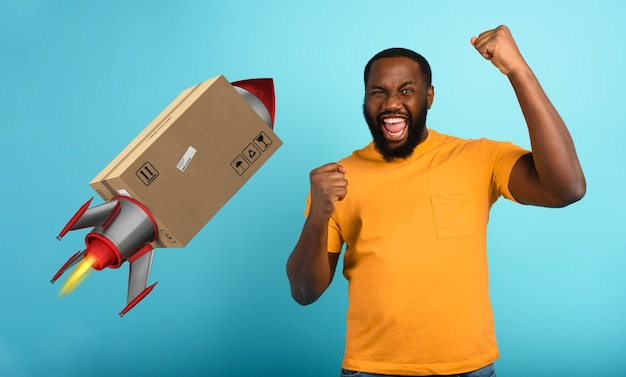 Black man is happy to receive a package. concept of fast delivery like a rocket.