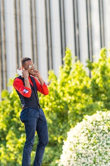Black man listening to music an mobile phone