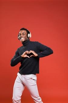 Black man posing with headphones