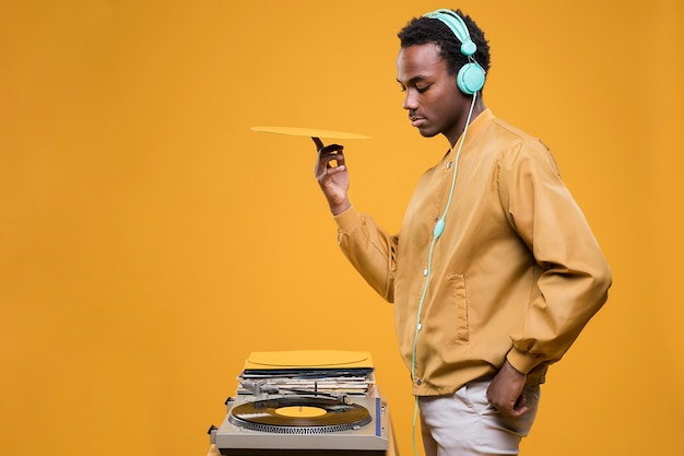 Black man posing with headphones