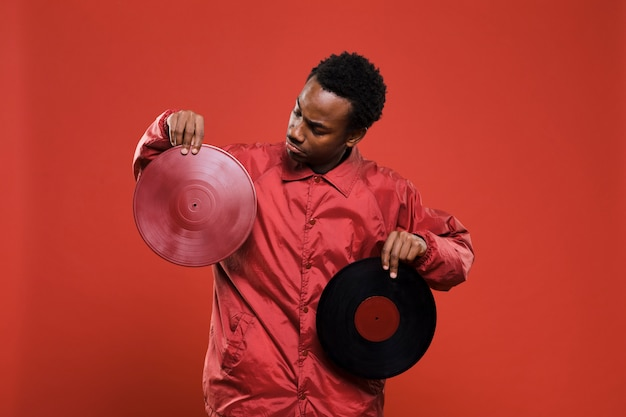 Black man posing with vinyls