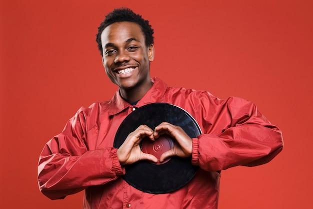 Black man posing with vinyls