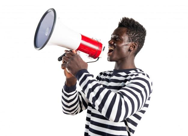 Black man shouting by megaphone