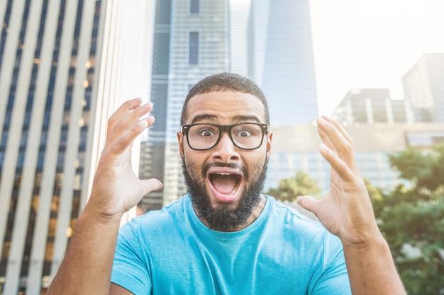 Black man shouting at camera