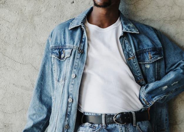 Black man wearing a silk screen white t-shirt