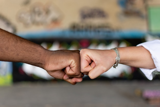 Black man and white woman clenching their fists. union concept. stop racism.