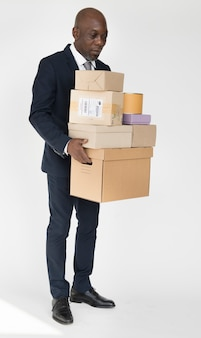 Black man with a bunch of boxes