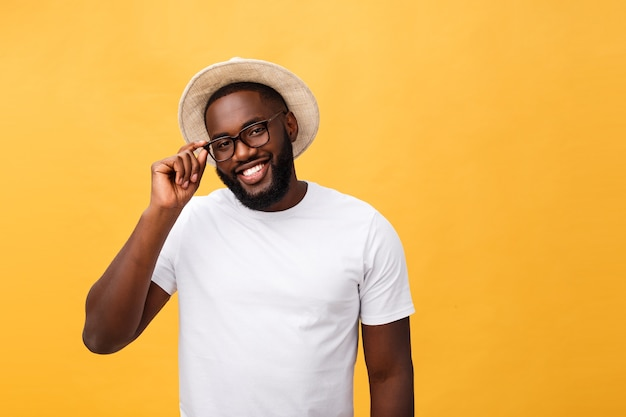 Black man with hat and cheerful expression.