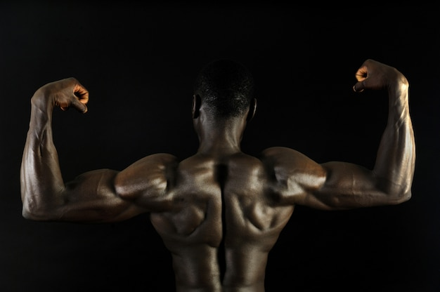 A black man with a muscular body