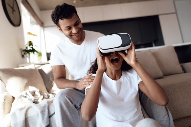 Black man and woman are sitting on the couch vr