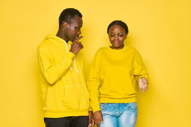 Black man and woman couple with yellow clothing