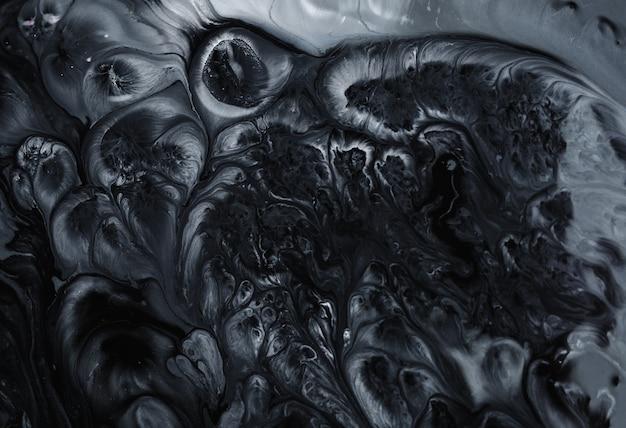 背景の黒い大理石の自然なartパターン