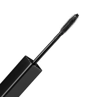 The black mascara brush isolated on white background. selective focus
