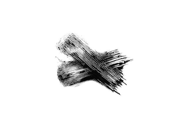 Black mascara brush stroke on white background. cosmetology product for eyelashes makeover.